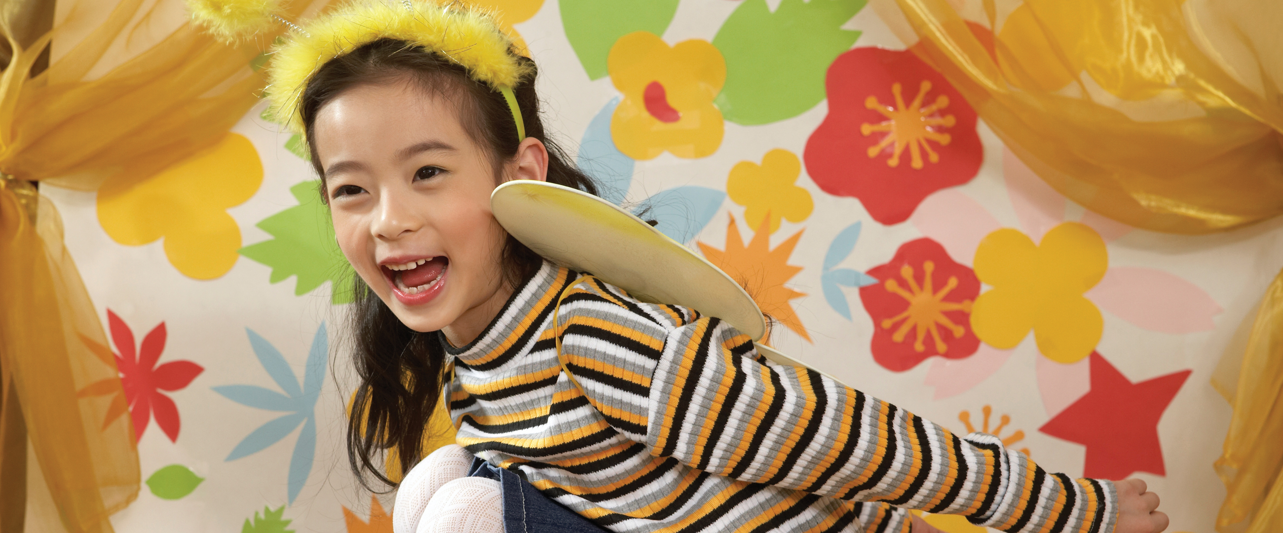 young smiling girl playing