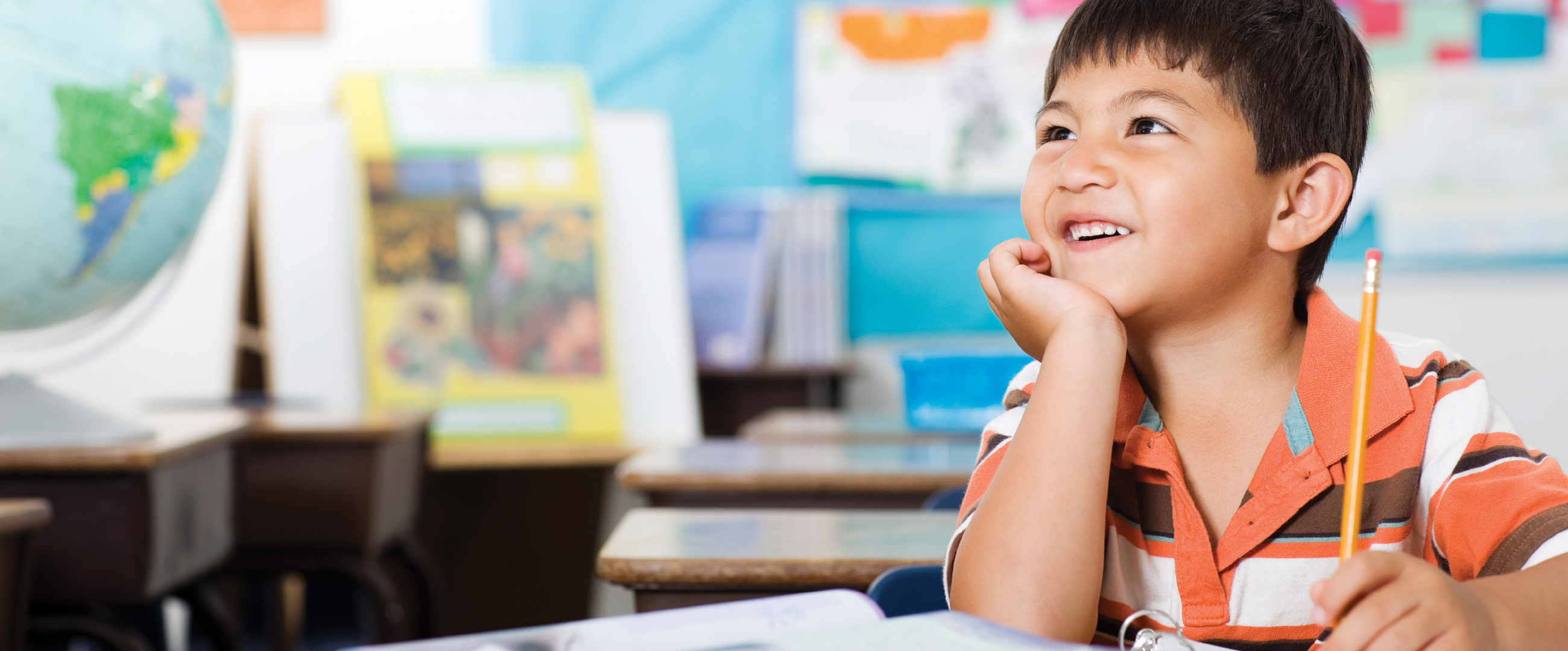 young smiling boy in classroom